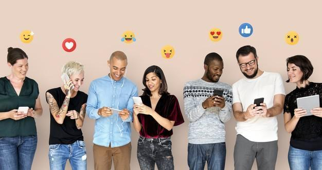 Happy diverse people using digital devices Free Photo