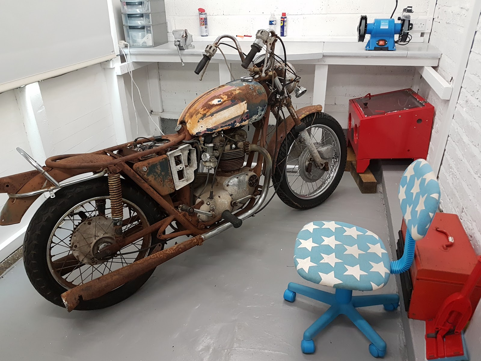 My new bonneville T120 in its new workshop home ready to be worked on.