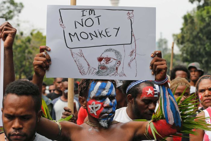 A Papuan student holds a poster saying 'I'm Not Monkey' during a protest in Jakarta.