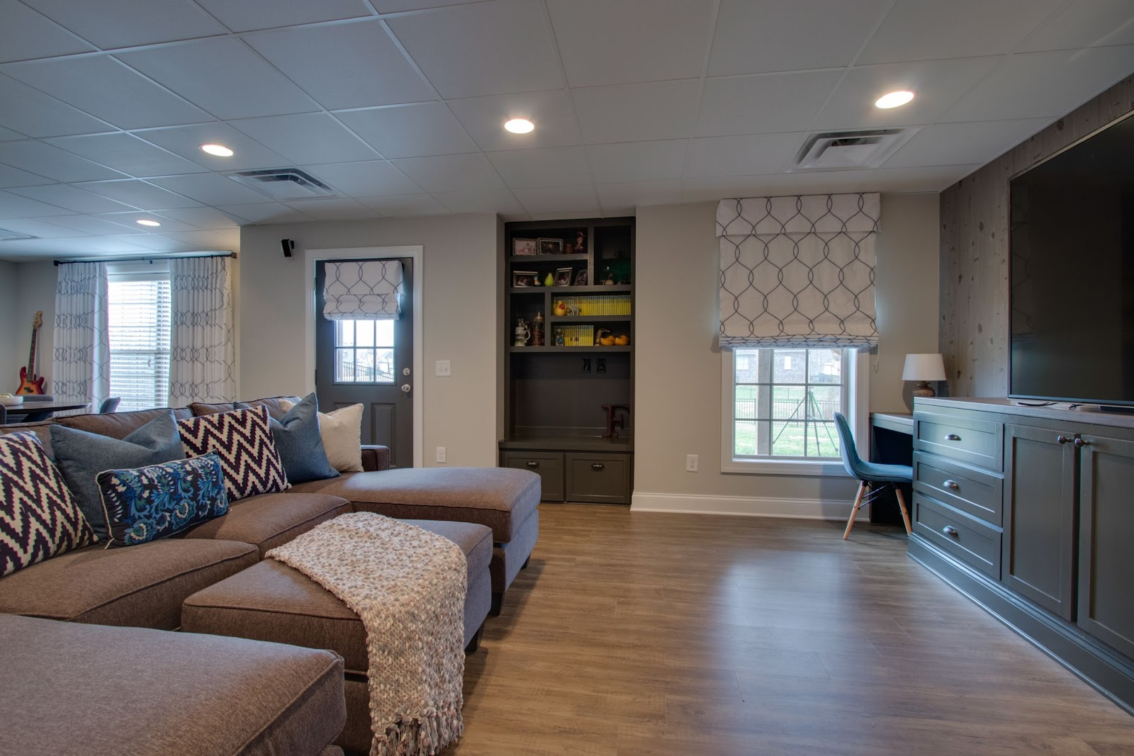 superior construction and design create a multi-functional space living room with office space