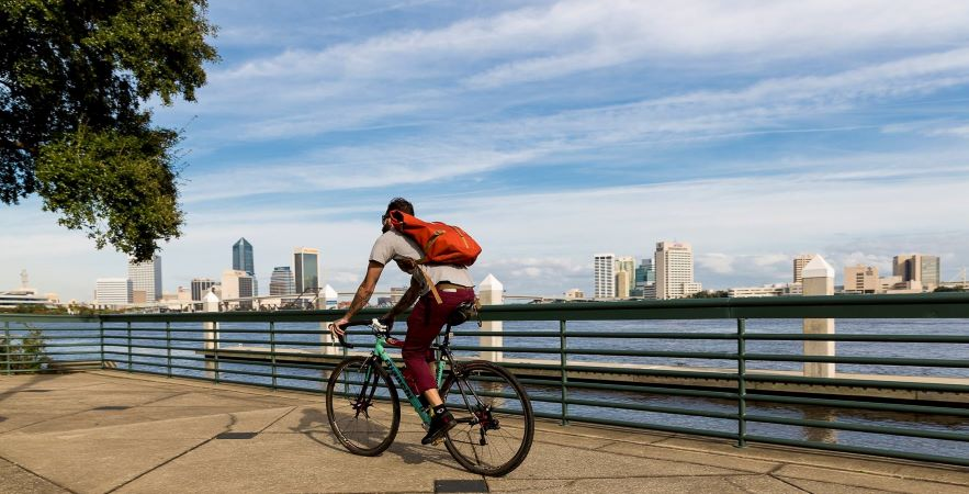 man bicycling on Florida boardwalk
