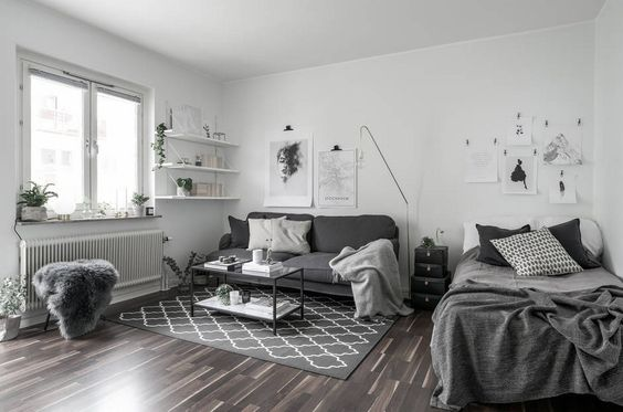Place a Dark Gray Sofa in white bedroom