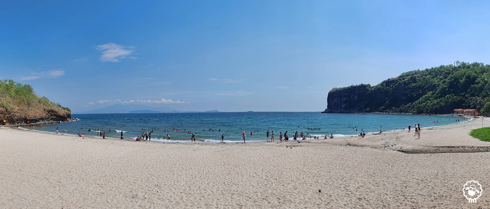 Beach and shores with clear sky and rock mountain formation