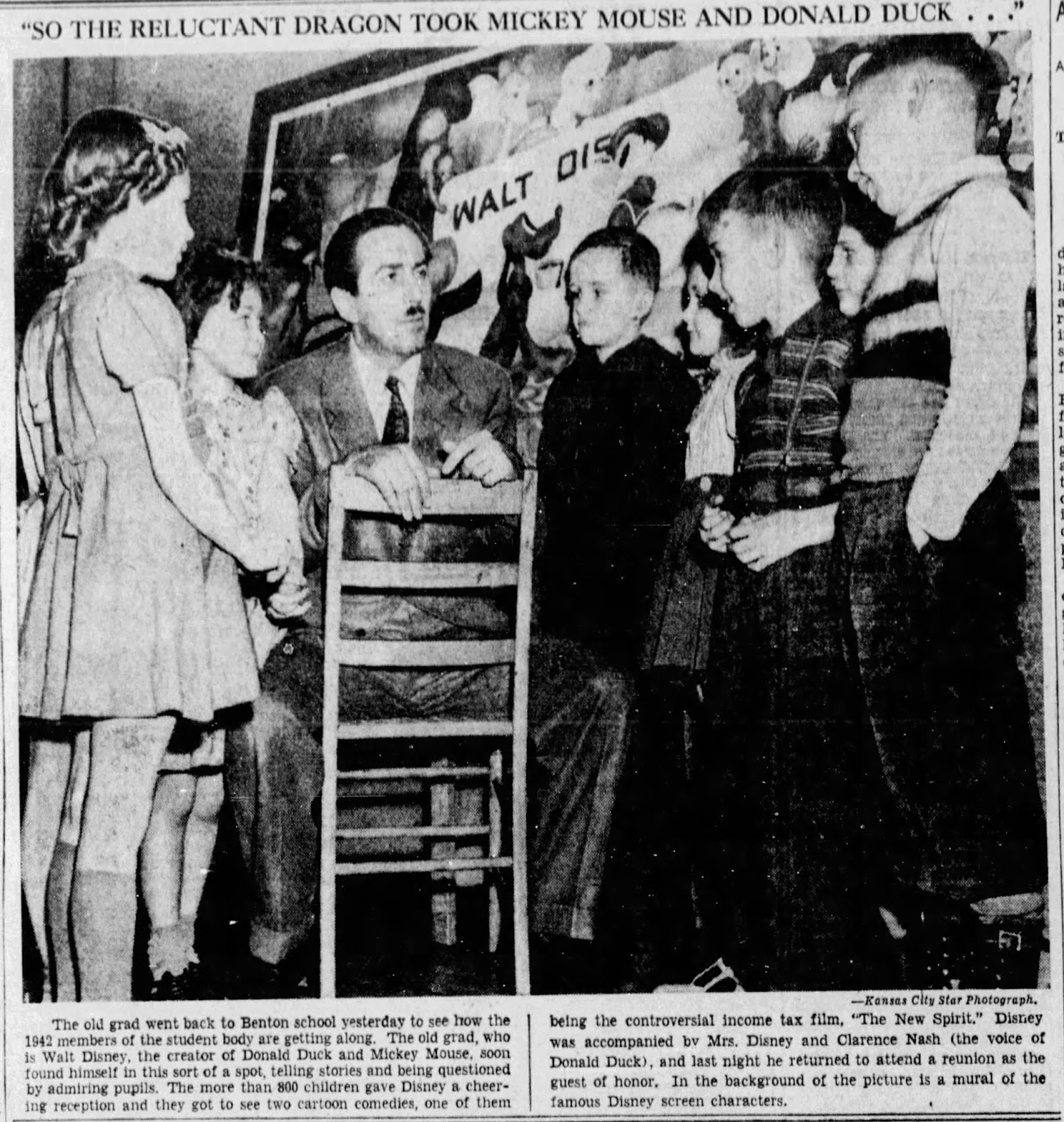 In one of the only known photographs of the murals, Disney can be seen in front of the gifted artwork visiting with school children.