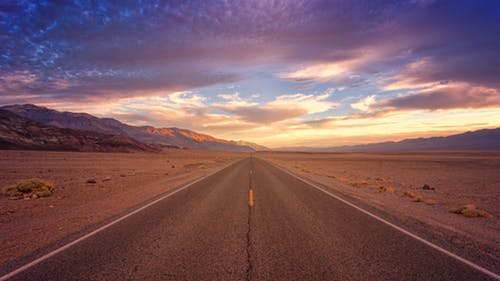 Gray Pavement Road Towards Mountains