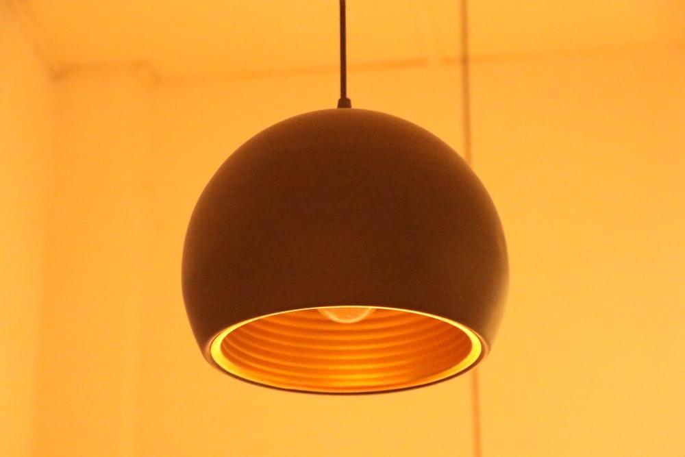 black pendant lamp turned on in room