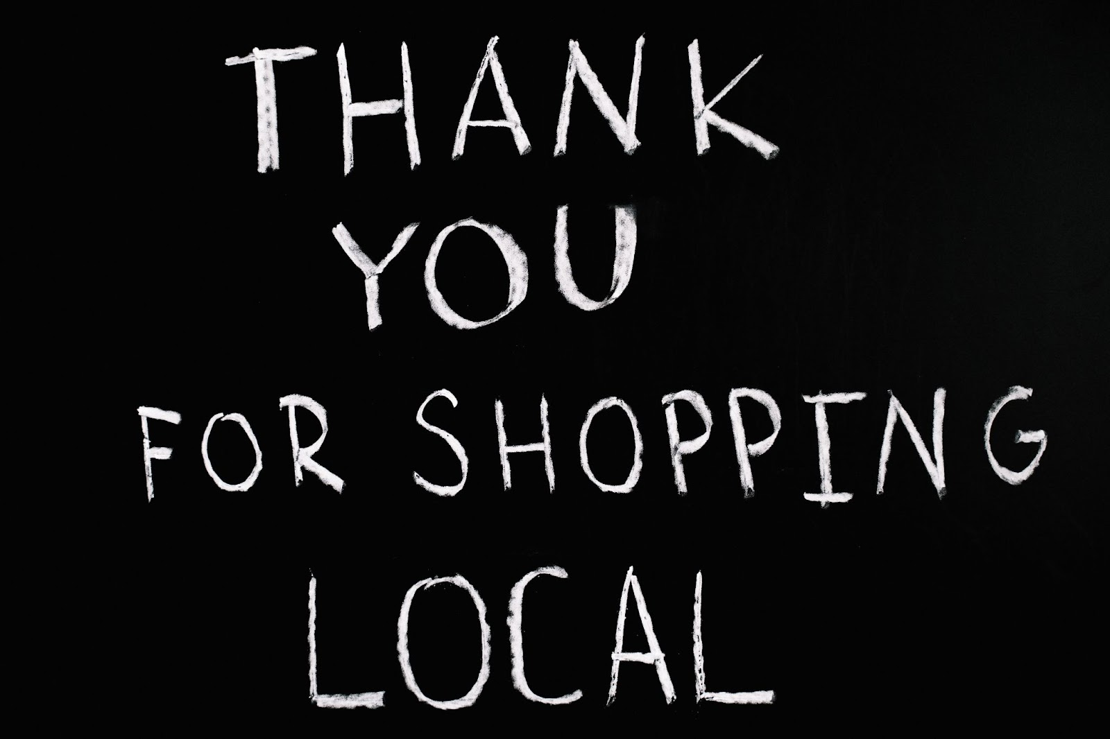 sign thanking for shopping local