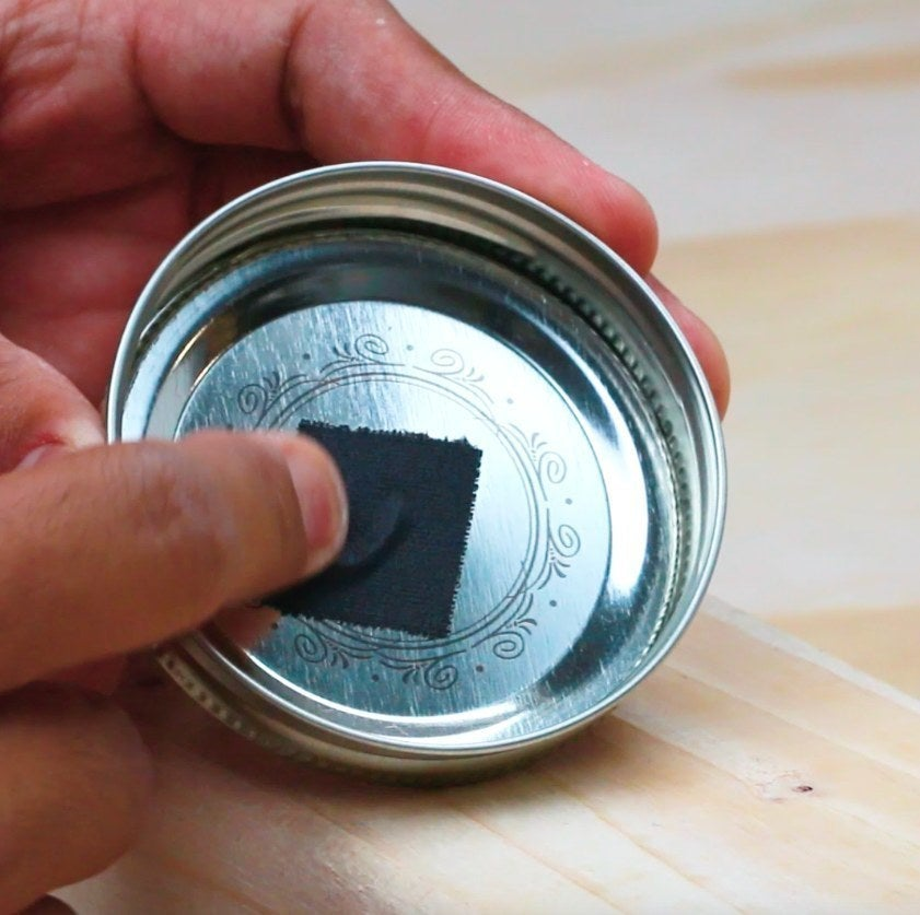taping wire to a mason jar lid