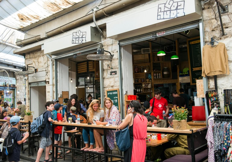 Young crowed sitting in popular restaurants and bars in the Machane Yehuda market in Jerusalem.