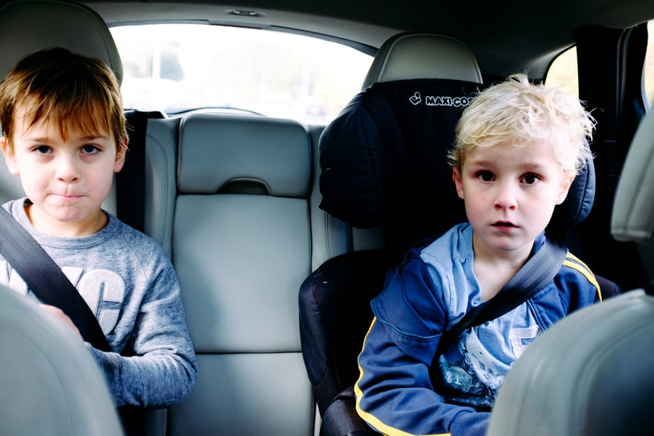 children riding in the back seat of a car