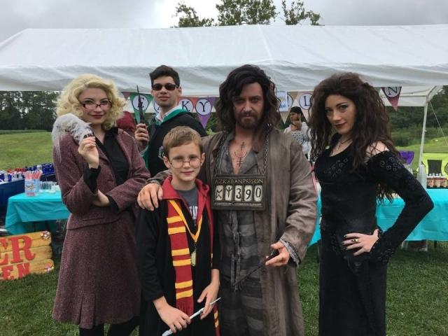 group of people dressed up as Harry Potter characters in front of a tent