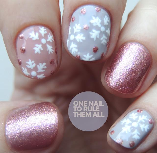 Mauve & gray holiday manicure with assorted nail art, including purple shimmer & white snowflakes