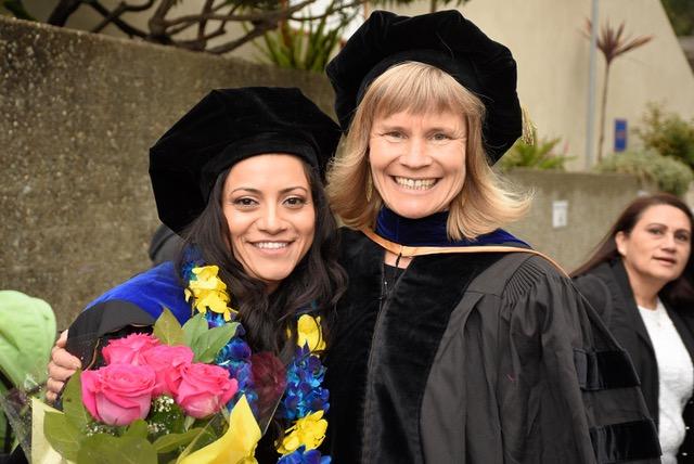 Professor Kara Nelson at graduation with recent graduate