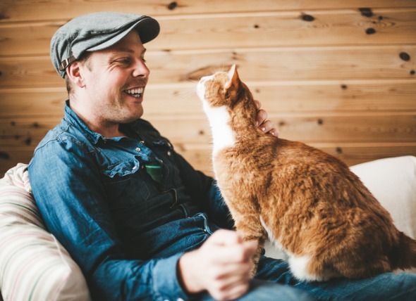 Man and cat looking happily at each other