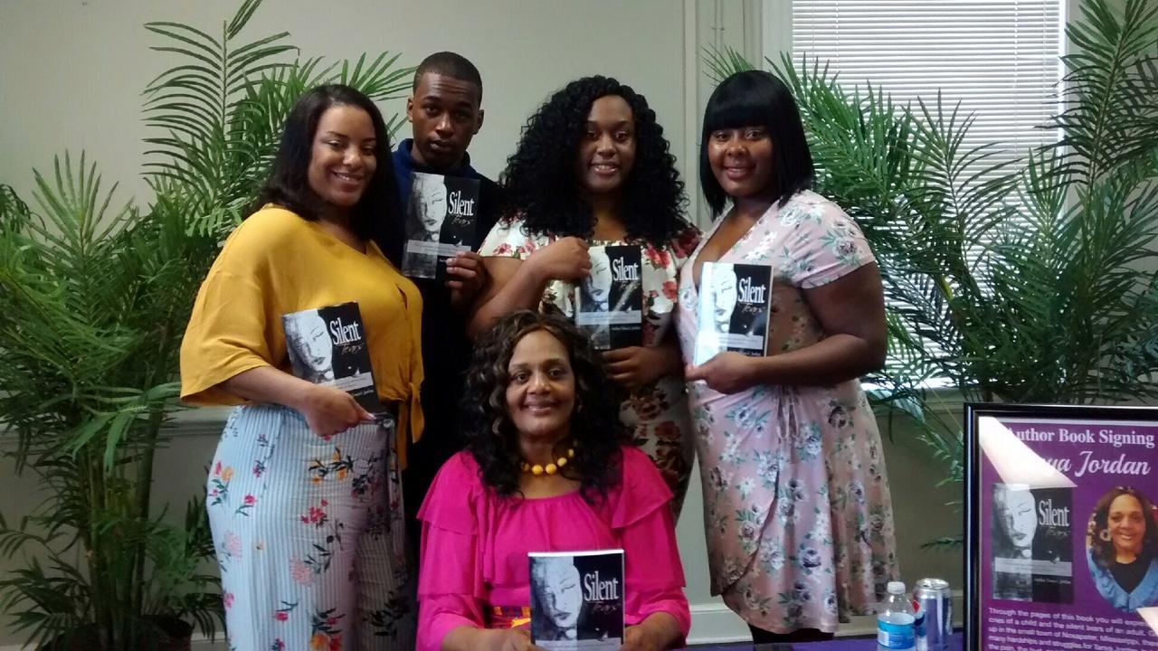 C:\Users\Elmetra\Downloads\Tonya Jordan book signing with children.jpg