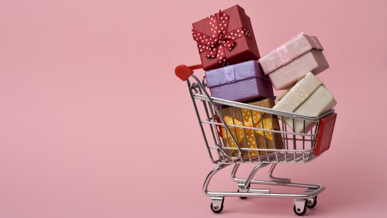 a shopping cart full of holiday gifts