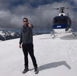eCom elites franklin hatchett on a snow covered mountain with a helicopter in the background