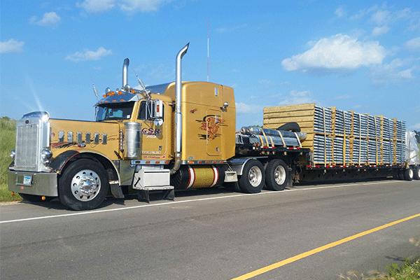 Step deck semi truck hauling freight