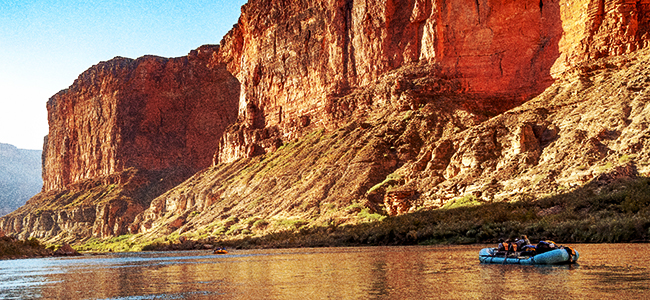 Rafters travelling down the Colorado River in the Grand Canyon.