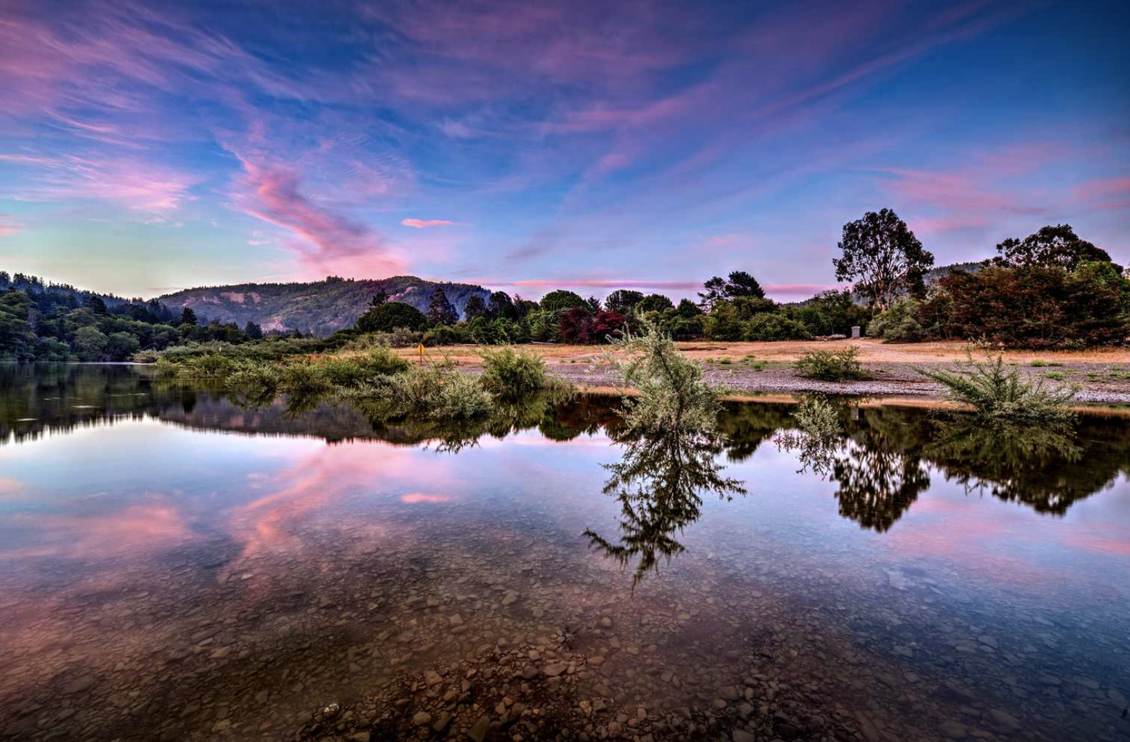 Water at Casini Ranch campground during sunset with purple sky