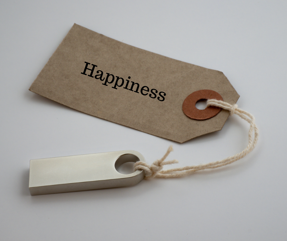 "A brown gift tag with the word ""happiness"" written across it in black letters: the price people pleasers pay when they agree to things they don't want to do."