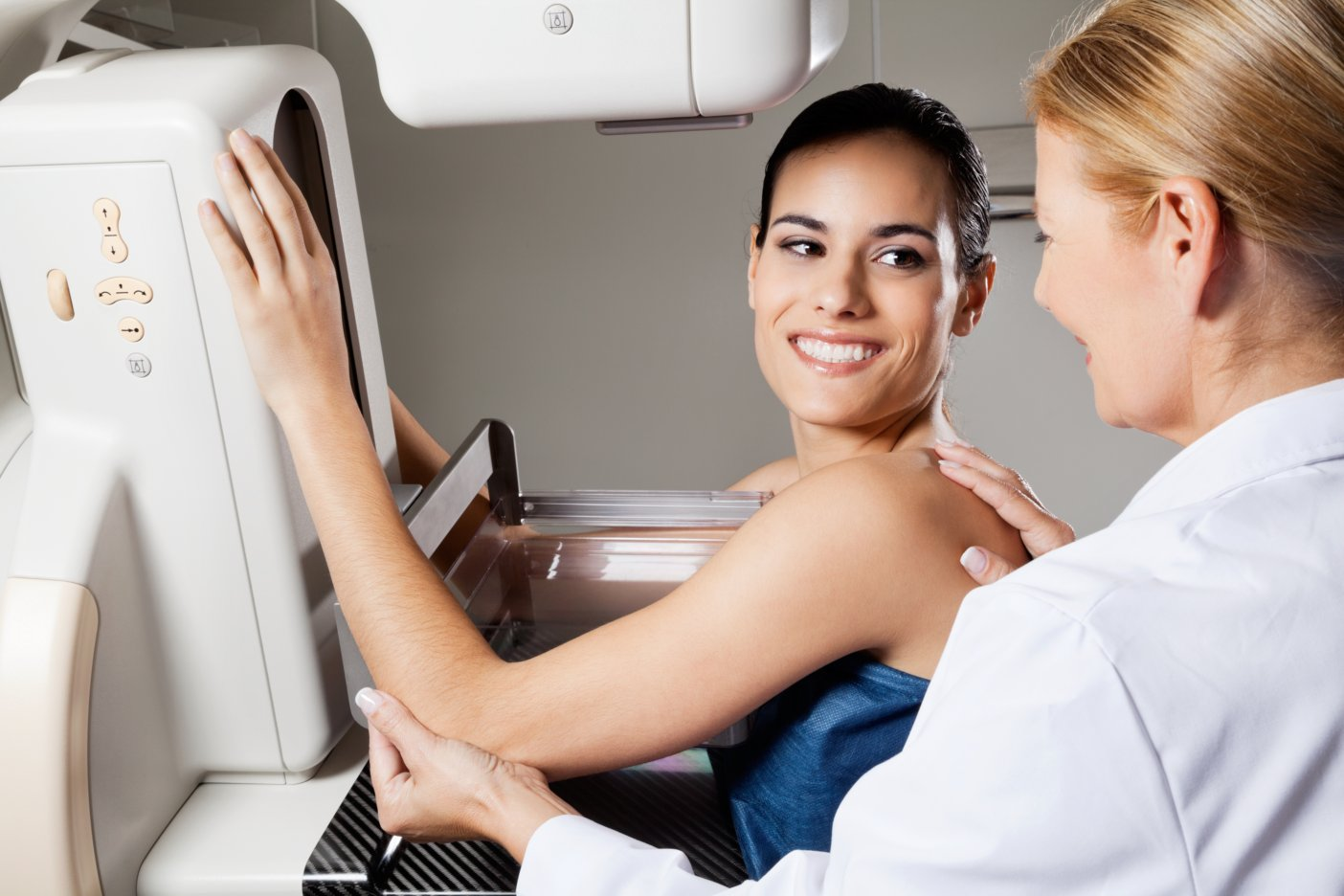 Practitioner doing a mammogram for a patient