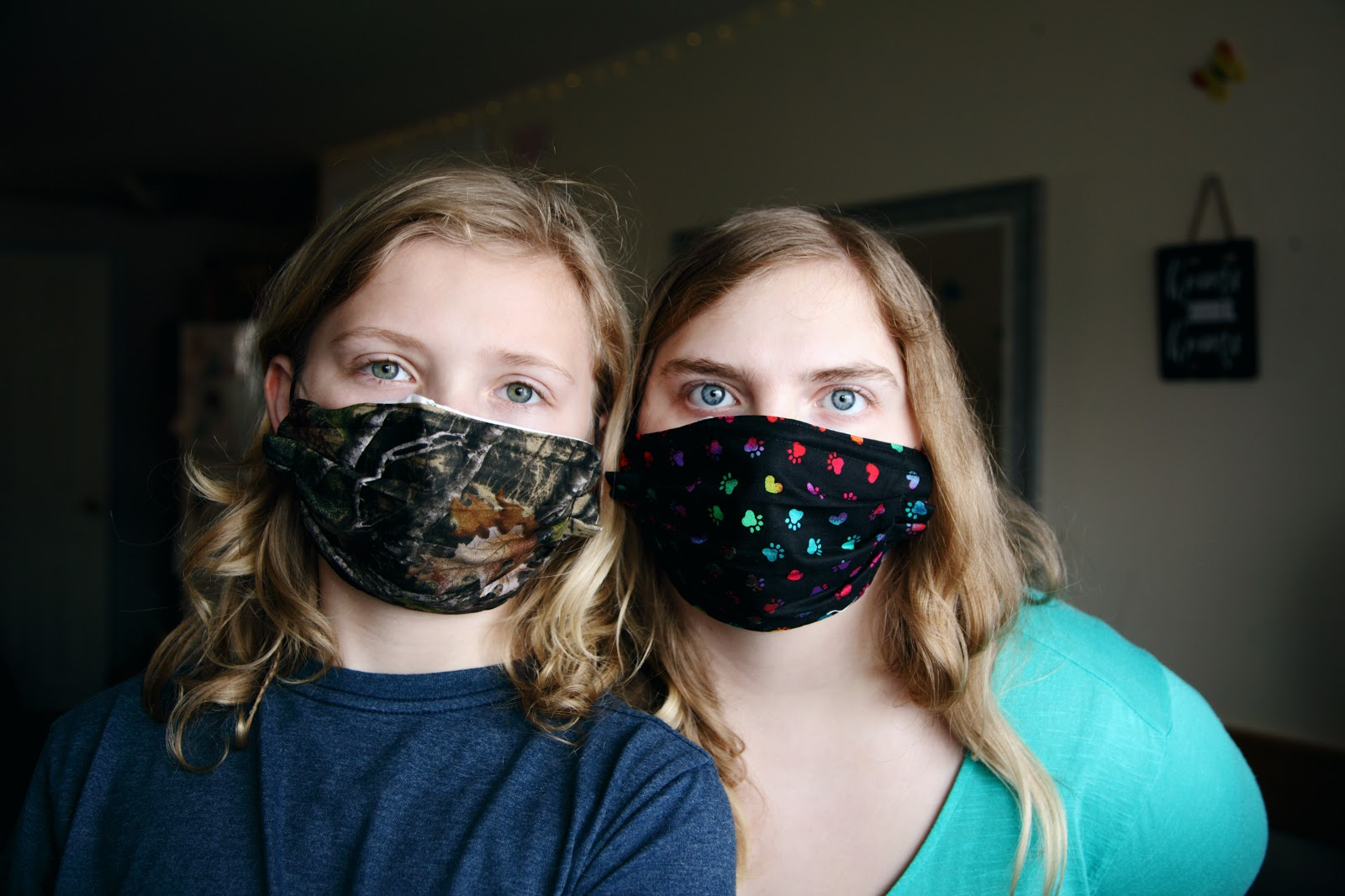 two people wearing reusable masks for daily use
