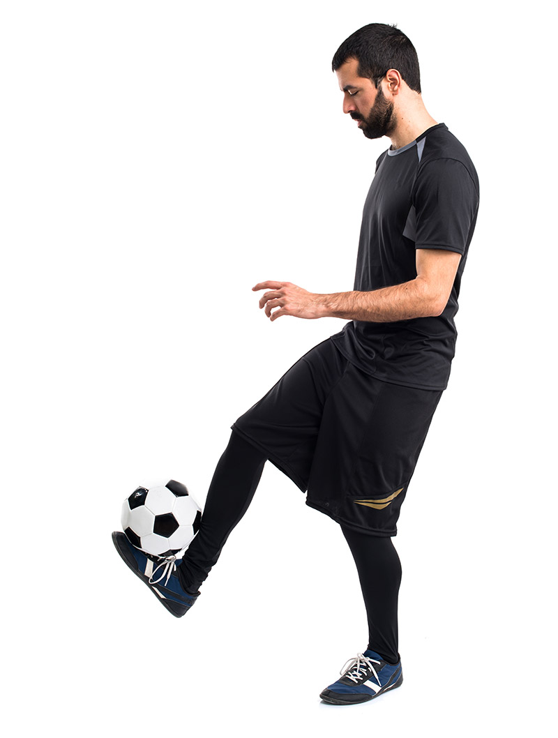 Juggling a soccer ball with ball balanced on foot