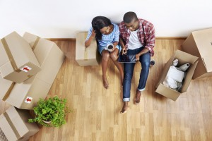 two home buyers surrounded by moving boxes