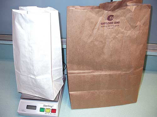 Disposable paper bags make easy restraint devices to weigh small birds and require no cleaning