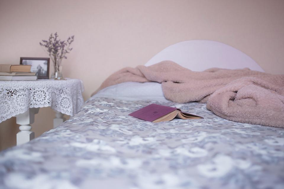 bed with a fluffy pink blanket on it