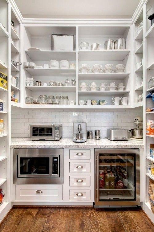modern white pantry with extra dishware storage, appliances, mini fridge