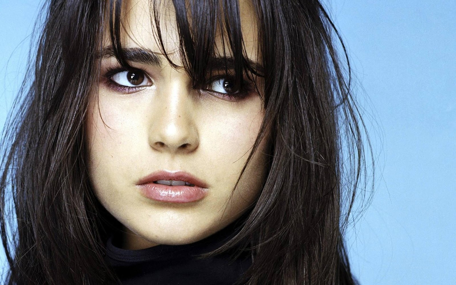 Macintosh HD:Users:nataliewright:Downloads:women-close-up-actress-long-hair-celebrity-jordana-brewster-blue-background-bangs-fresh-hd-wallpaper.jpg