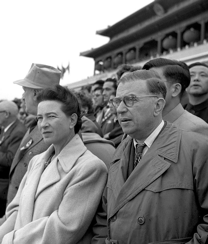 Simone de Beauvoir and Jean-Paul Sartre in a crowd during a visit to communist China.