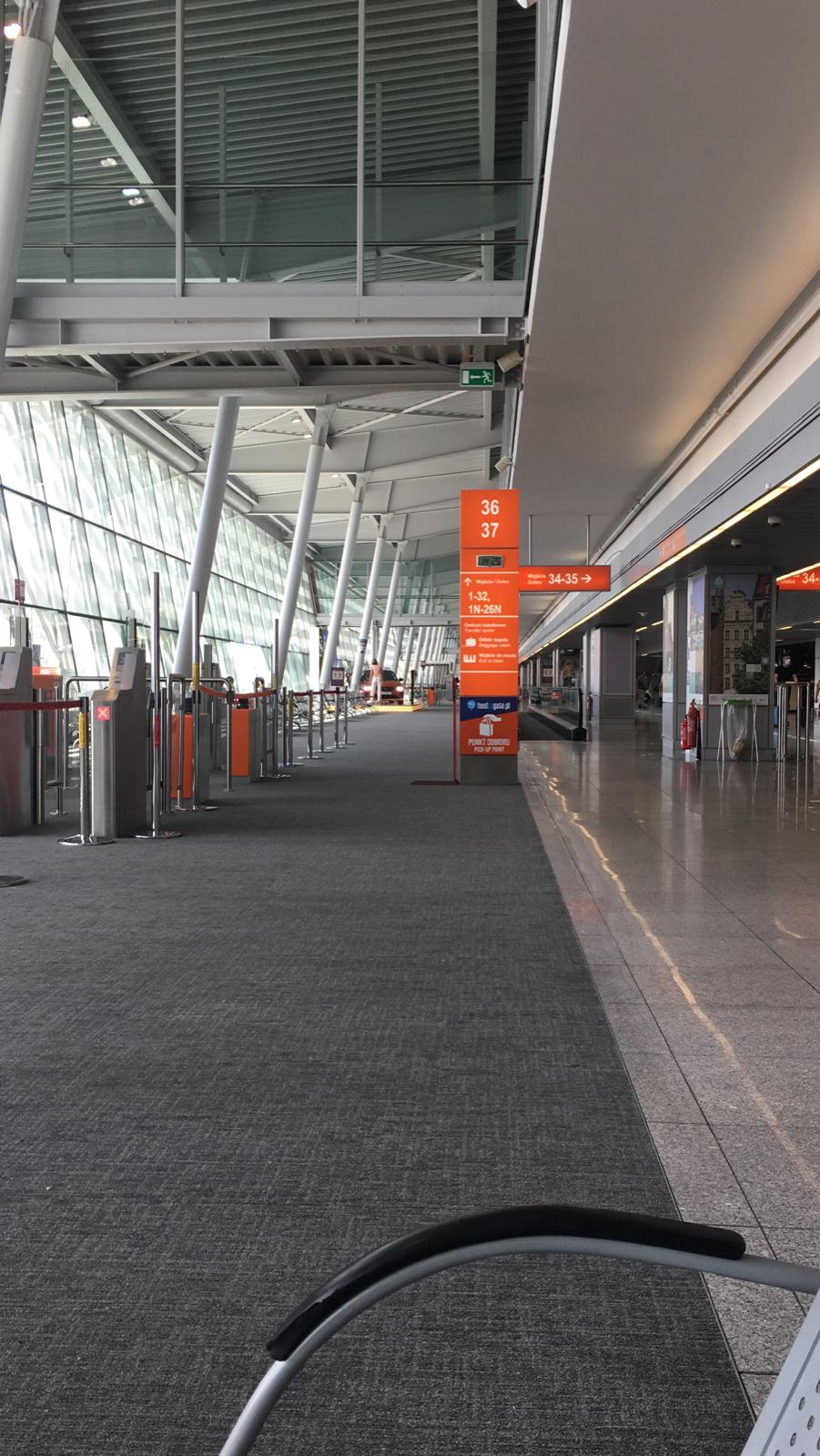 warsaw chopin airport interior, gate 36 is completely empty during the coronavirus pandemic. Flights resumed, no people in terminal building.