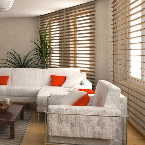 A living room with white couches  Description automatically generated with low confidence