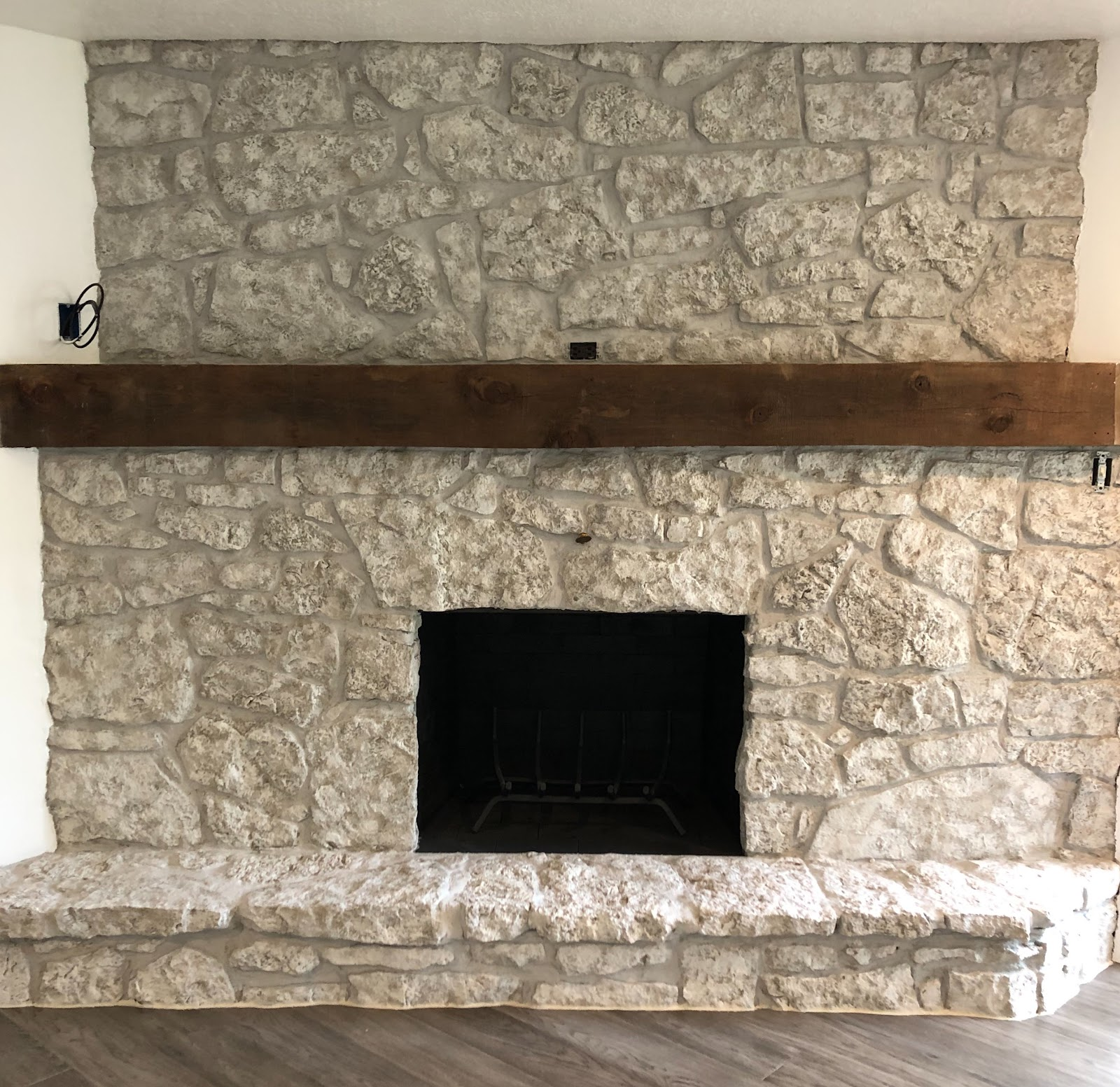 stone fireplace painted with the Brick-Anew painting system