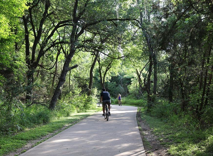Two people biking on Southern Walnut Creek Trail.