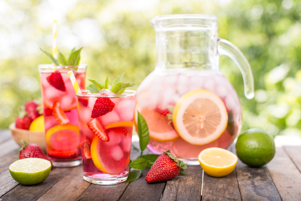 strawberry lemonade pitcher with glasses