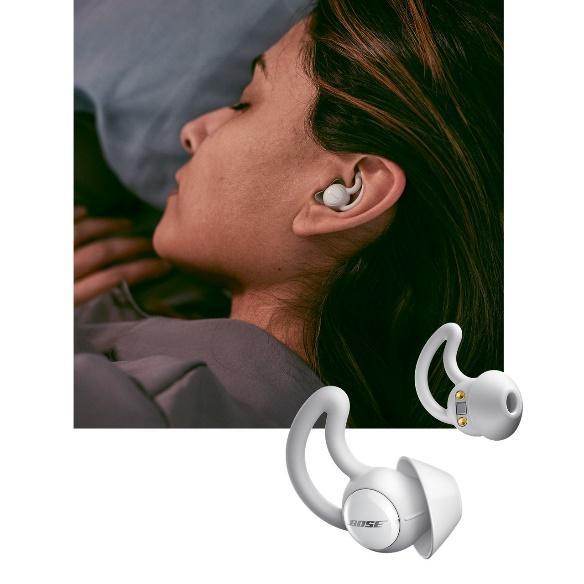 Woman sleeping with Bose noise-masking sleepbuds