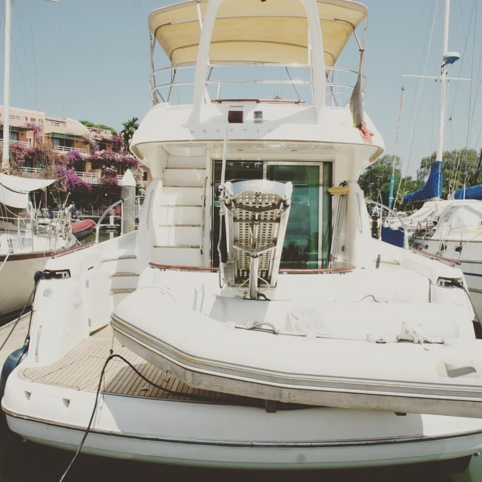 A picture containing boat, outdoor, table, sittingDescription automatically generated