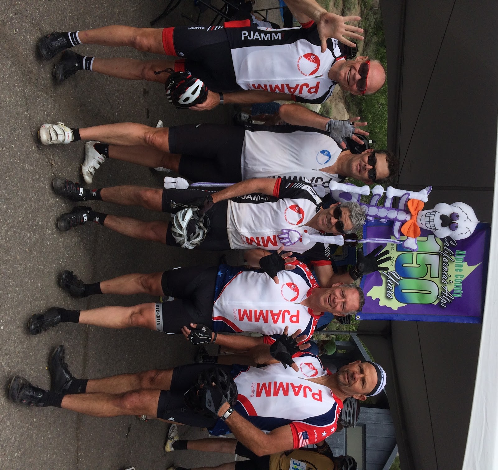 Cycling Monitor Pass East and West - PJAMM cyclists at finish of Death Ride holding up 5 fingers for 5 passes - skeleton