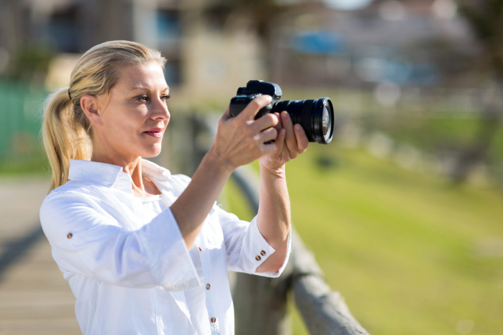 attractive middle aged woman practicing photography