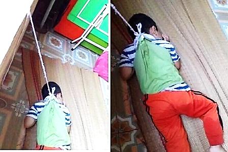 Hình ảnh học sinh mầm non bị buộc vào cửa sổ lớp học bằng một sợi dây do một phụ huynh chụp lại.