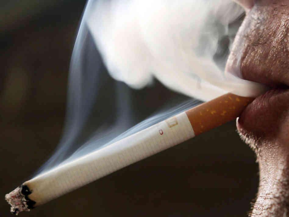 person smoking, smoking
