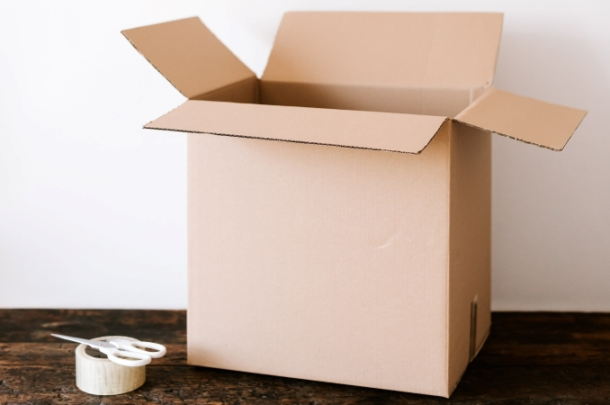 moving box, packing tape and scissors
