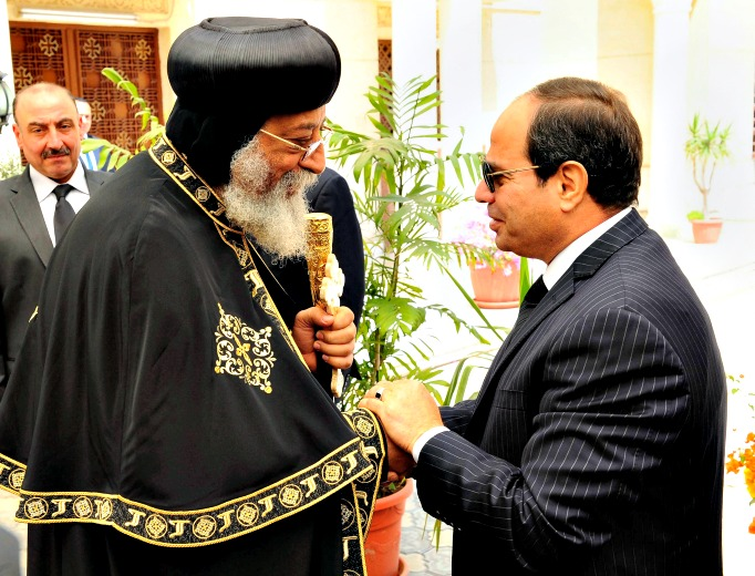 In this photo provided by Egypt's state news agency, MENA, Egyptian President Abdel-Fattah el-Sissi, right, offers condolences to Coptic Pope Tawadros II for the victims of twin bombings on Palm Sunday in the cities of Tanta and Alexandria, at St. Mark's Cathedral, in Cairo, Egypt, Thursday, April 13.