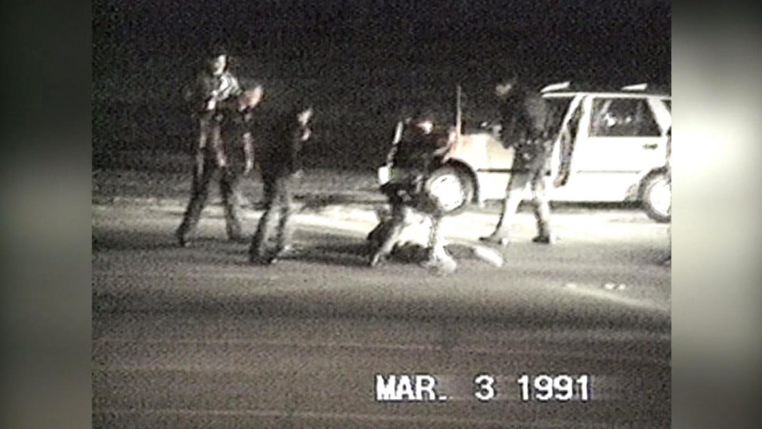 an old surveillance photo of police beating a man