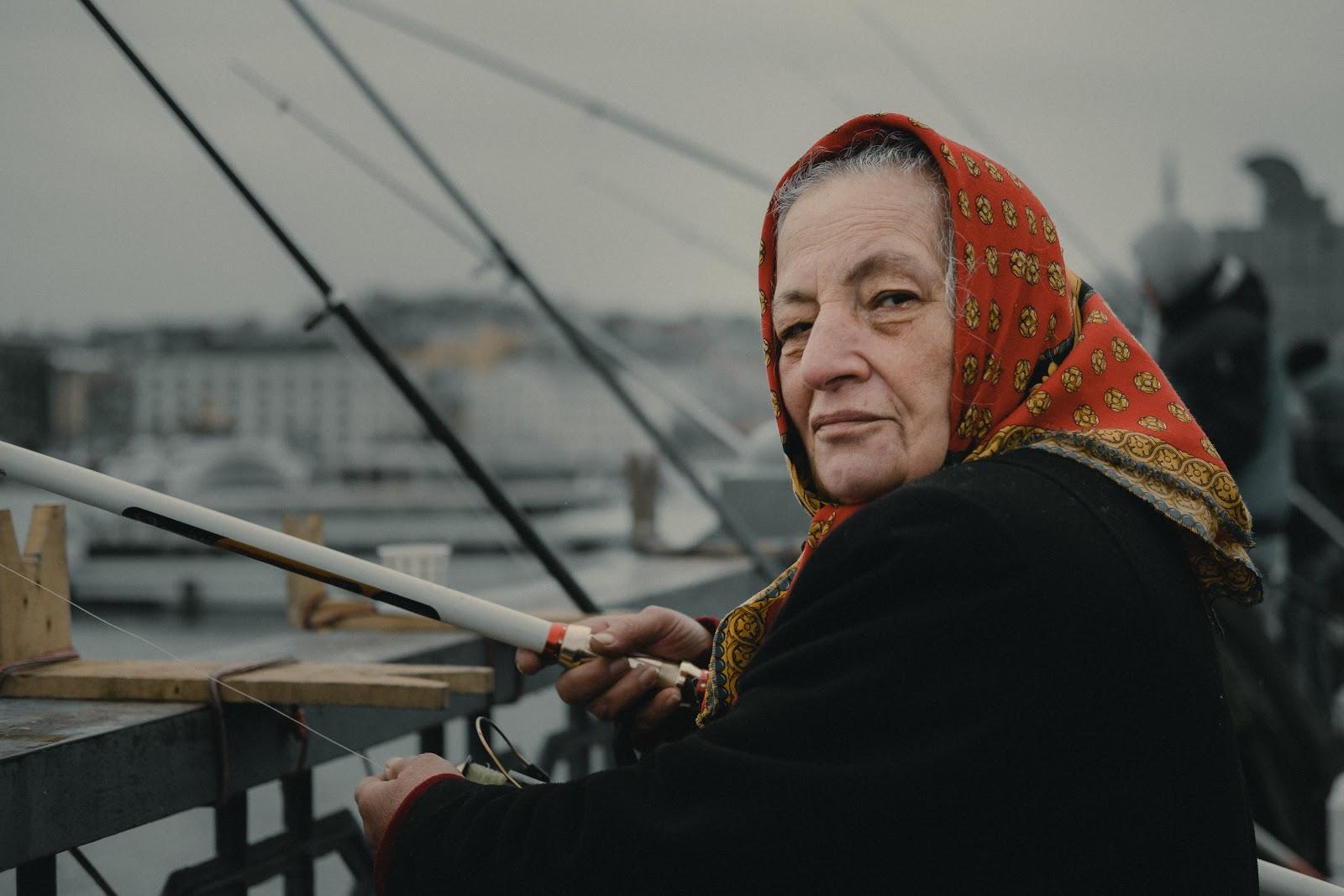 fishing in İstanbul grandma on the bridge
