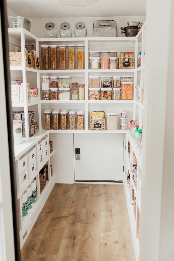 large walk in white pantry design with matching glass jars and containers